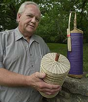 The Rev. Brian Bergin holds the fireworks shell that contains his father's (Rev. George Bergin) ashes.